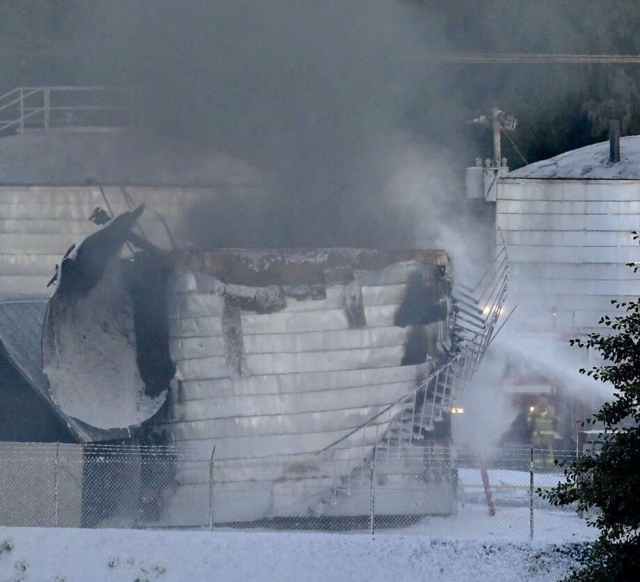Firefighters on Thursday were at the scene of a tank explosion at a Glenville asphalt plant that force authorities to evacuate a nearby hotel on Freemans Bridge Road. Photo: Skip Dickstein / Timees Union