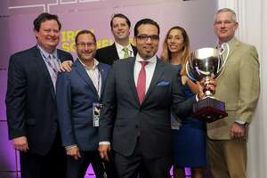 Christian Varas, center, wine director forRiver Oaks Country Club, won the 2016 Iron Sommelier competition.