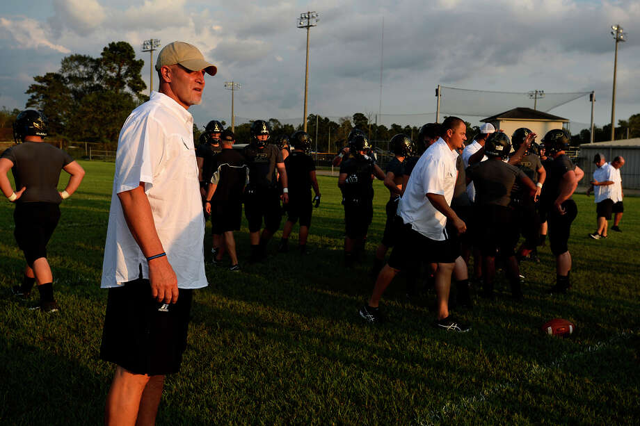 Vidor head football coach Jeff Mathews watches as the team warms up before their season opener against Central on Tuesday night.  Photo taken Tuesday 9/26/17 Ryan Pelham/The Enterprise Photo: Ryan Pelham / ©2017 The Beaumont Enterprise/Ryan Pelham