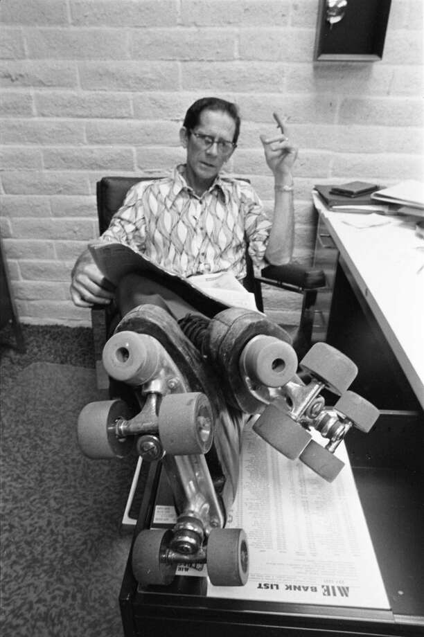 10/13/1972 - Spec Jackson wears his roller skates even when handling his office duties at Spec's Warehouse at 2310 Smith. Photo: Darrell Davidson, HC Staff / Houston Chronicle