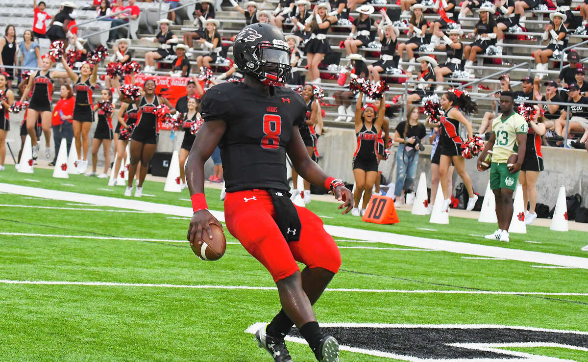 Langham Creek QB Chris Herron rushes for a touchdown against Cy Falls at Cy-Fair FCU Stadium. Herron has rushed for four touchdowns on the season and thrown for four more in leading the Lobos to a 2-0 record with the most dynamic offense in the league.