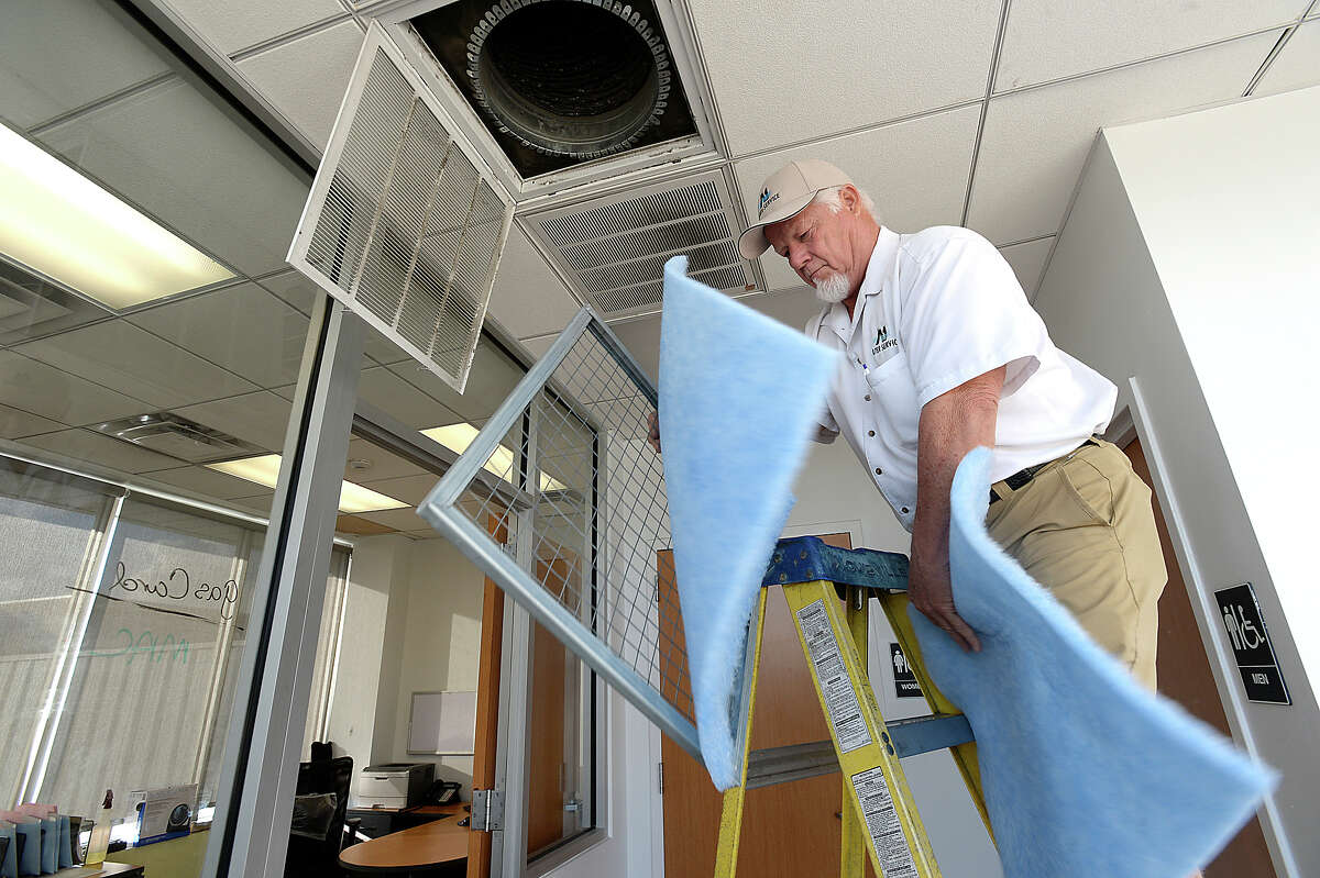 Mike Kibodeaux with A1 Filters replaces air filters at the Twin City car dealerships in Nederland Tuesday. The business was out of work for three weeks due to clients being closed during Tropical Storm Harvey. Photo taken Tuesday, September 26, 2017 Kim Brent/The Enterprise
