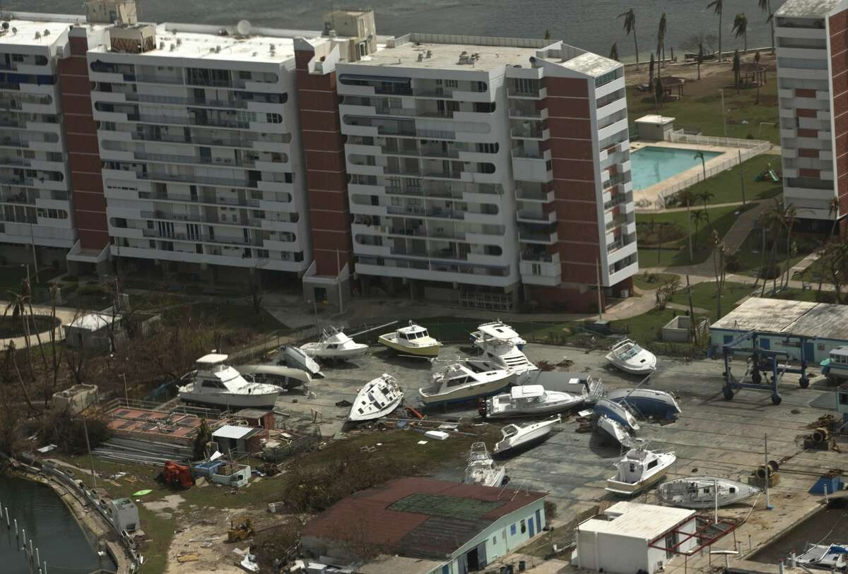 This aerial photo shows boats washed ashore in the aftermath of Hurricane Maria, east of San Juan, Puerto Rico, Wednesday, Sept. 27, 2017. The relief effort from Hurricane Maria in Puerto Rico has so far been concentrated largely in San Juan, and many outside the capital say they've received little or no help. (AP Photo/Ramon Espinosa)