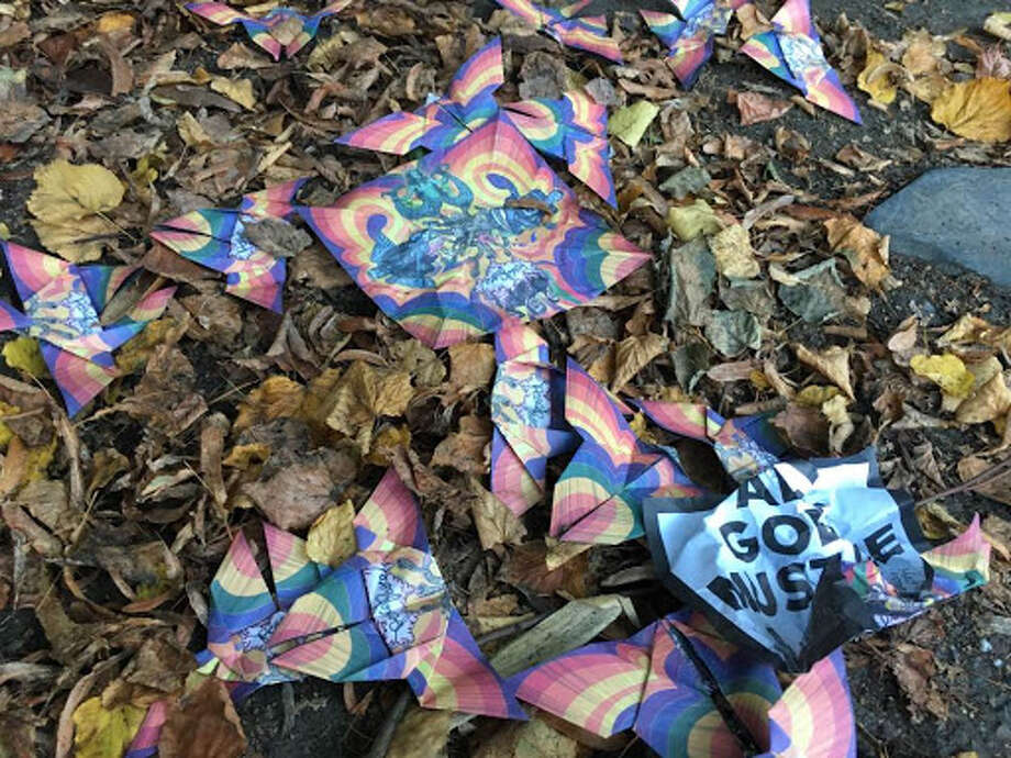 """The pamphlets seemed to have been dropped in Seattle parks and neighborhoods earlier this week, all teasing Thursday's big reveal with messages like """"You are not safe,"""" and """"All Gods Must Die."""" Photo: Zosha Millman"""