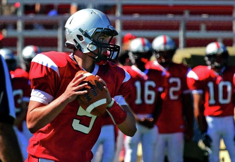 Warde quarterback Matt Cerminaro Photo: Christian Abraham / Hearst Connecticut Media / Connecticut Post