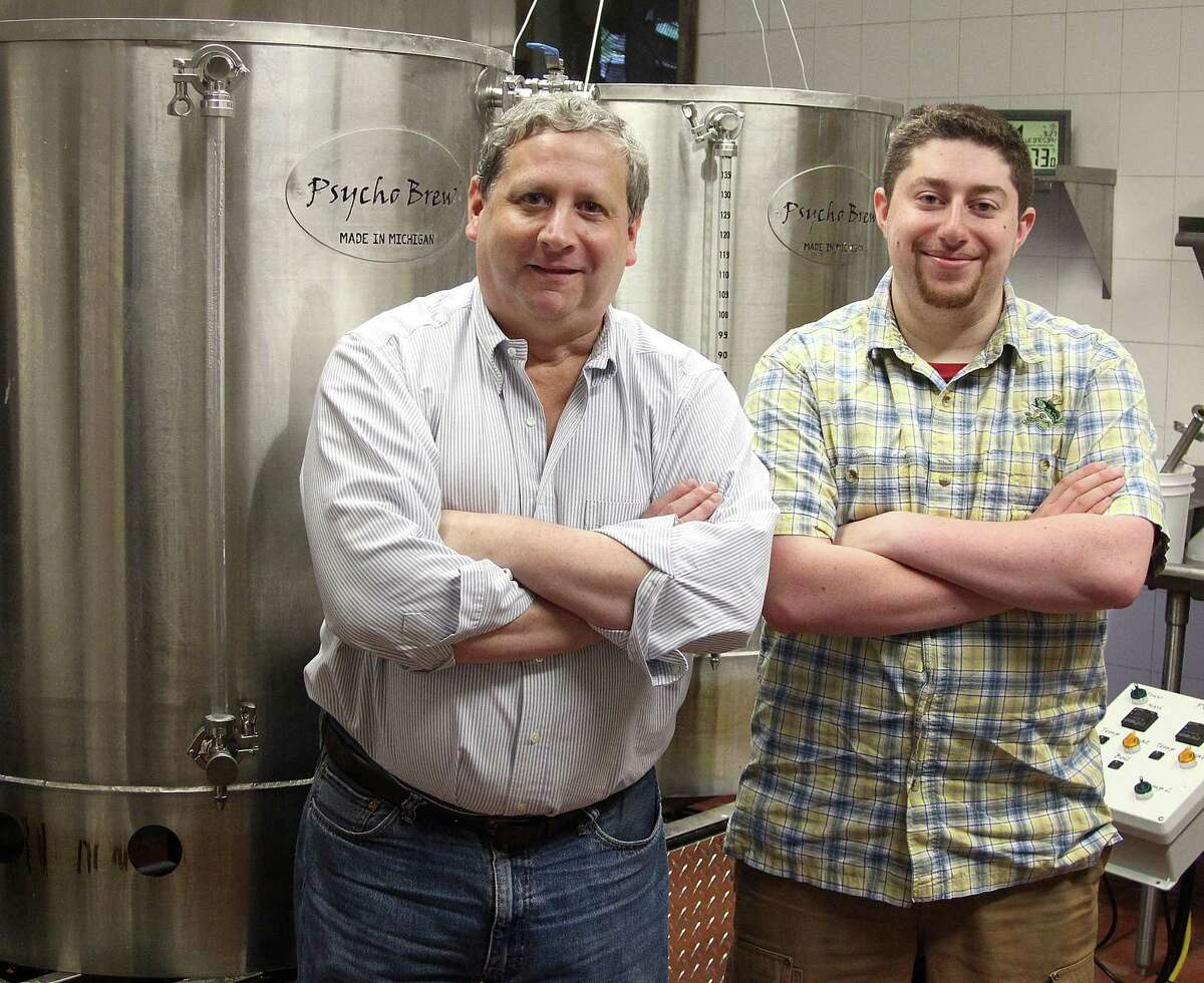 Jim and David Baulsir of Redding Beer Co. stand by the three-barrel brewing system at their new brewery in Redding, Conn., on Wednesday, Sept. 27, 2017.