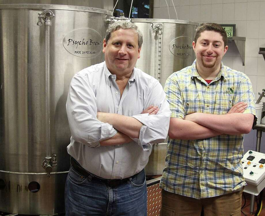 Jim and David Baulsir of Redding Beer Co. stand by the three-barrel brewing system at their new brewery in Redding, Conn., on Wednesday, Sept. 27, 2017. Photo: Chris Bosak / Hearst Connecticut Media / The News-Times