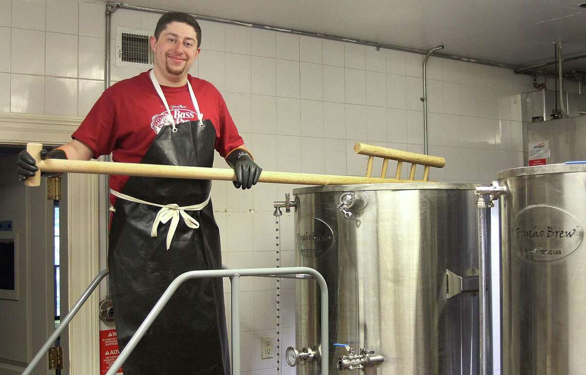 David Baulsir of Redding Beer Co. holds a mash paddle at the three-barrel brewing system at his new brewery in Redding, Conn., on Wednesday, Sept. 27, 2017.