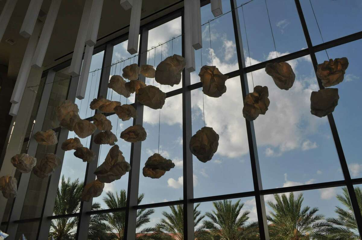 """""""Paper Cloud,"""" an installation on view at the Tobin Center for the Performing Arts, was conceived by Cade Bradshaw and Stuart Allen of Bridge Project and constructed by more than 90 individuals during a series of workshops."""