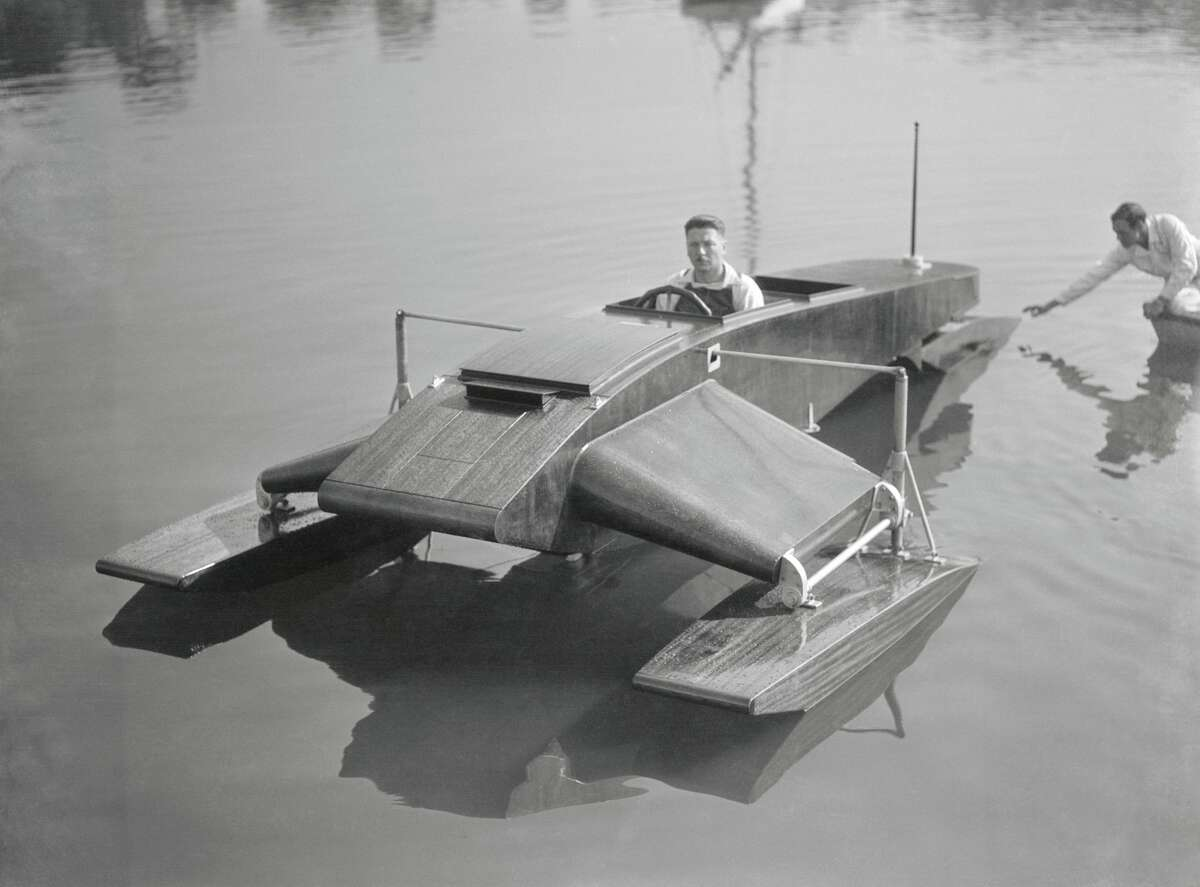 in 1932, Thomas Lake took a trial spin in his latest invention on the shore of Milford.He is the son of Simon Lake, famous submarine expert. His hydroplane was 20 feet long, seated two, and had a speed of one mile per each horsepower.