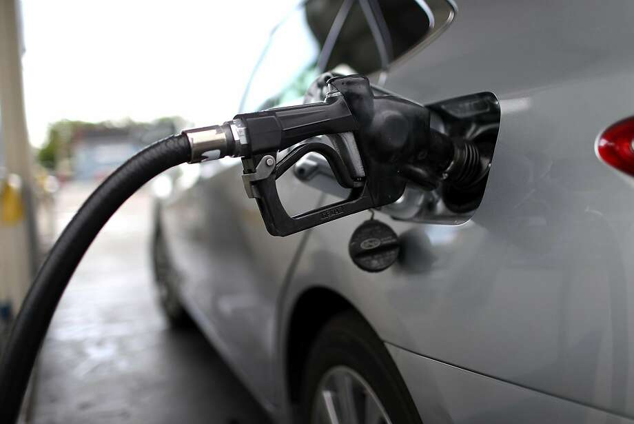 A car fills up with fuel in May at a gas station in San Rafael. Republicans and taxpayer protection advocates are trying to repeal increases in gas and car taxes. Photo: Justin Sullivan, Getty Images