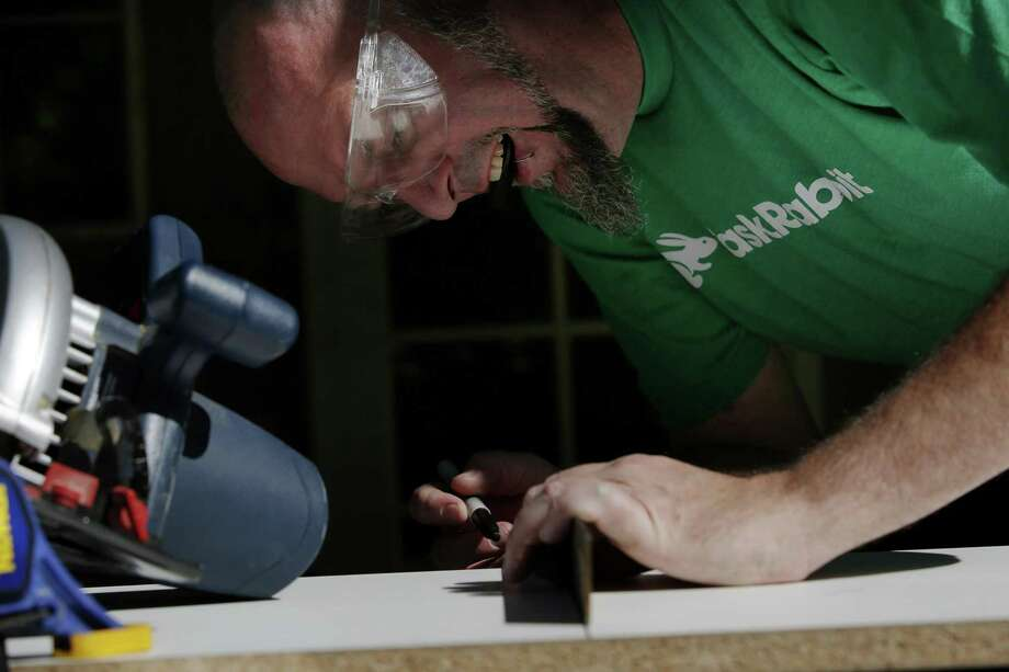 Duncan Cook marks wood to cut for a client's custom shelf on in April in San Jose, Calif. Cook left his full-time job to become a task rabbit. Photo: Santiago Mejia /San Francisco Chronicle / ONLINE_YES