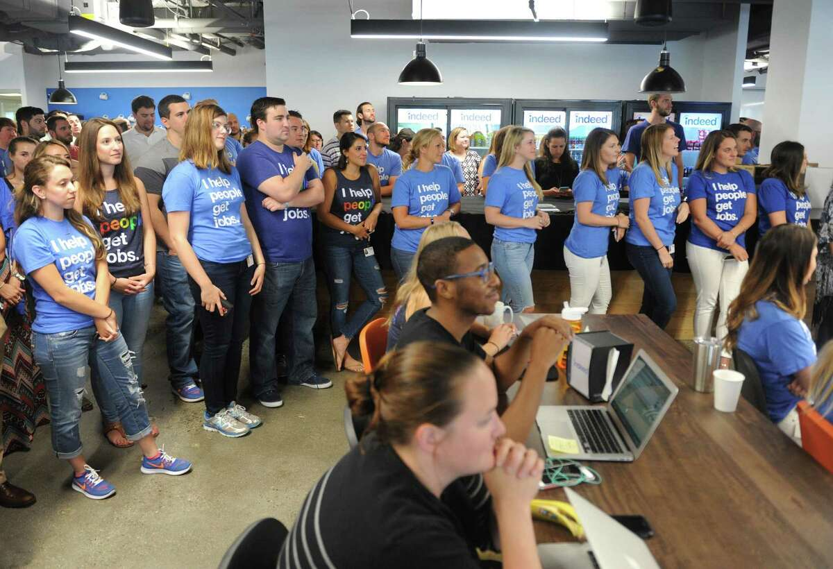 Indeed employees listen as Connecticut Gov. Dannel P. Malloy speaks at the Indeed headquarters in Stamford, Conn. Wednesday, July 12, 2017. Online job-search giant Indeed plans to create up to 500 new jobs over the next few years through tens of millions of dollars in company investment and state aid, Gov. Dannel P. Malloy and company executives announced Wednesday.