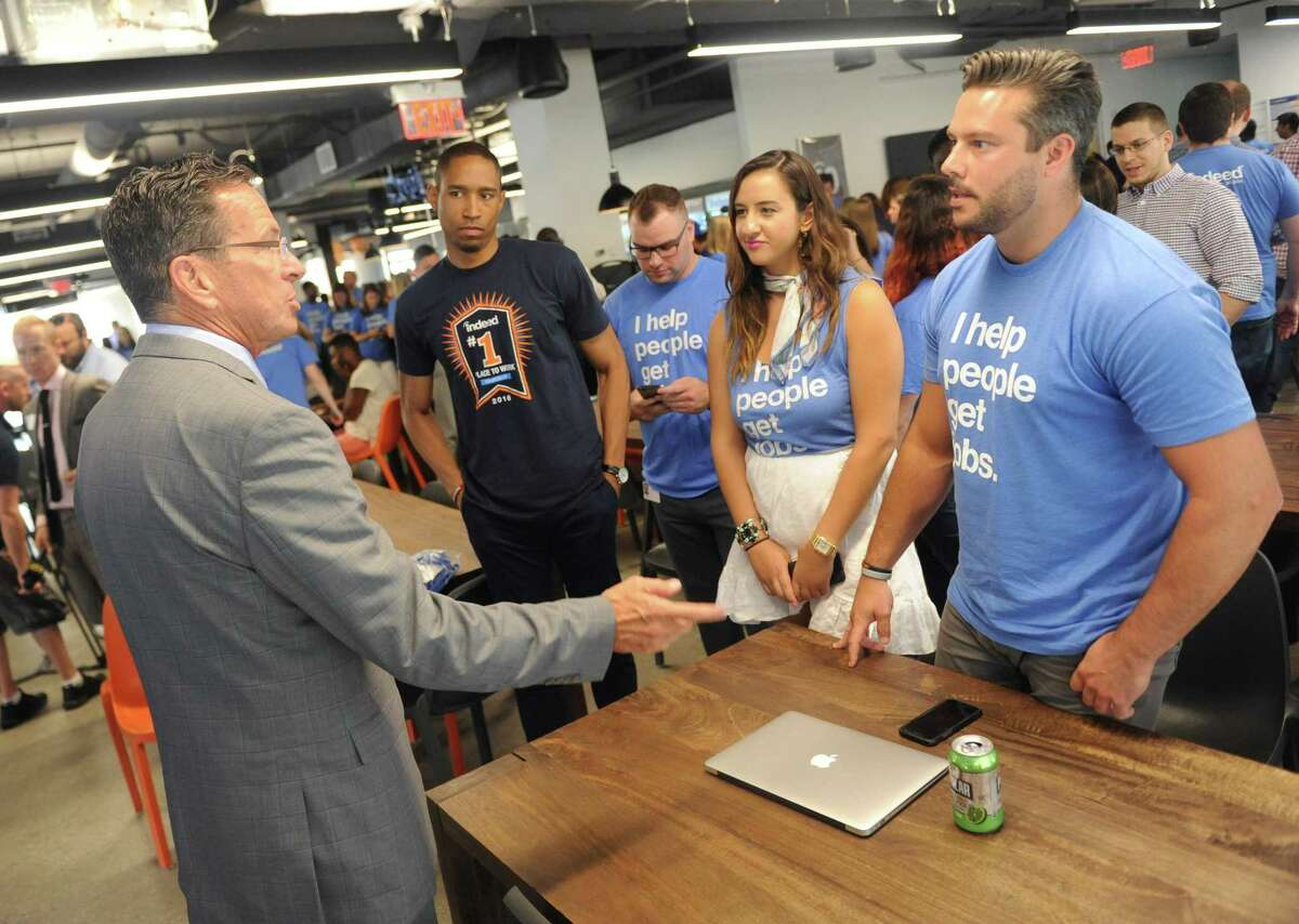 Connecticut Gov. Dannel P. Malloy chats with employees after making an announcement at the Indeed headquarters in Stamford, Conn. Wednesday, July 12, 2017. Online job-search giant Indeed plans to create up to 500 new jobs over the next few years through tens of millions of dollars in company investment and state aid, Gov. Dannel P. Malloy and company executives announced Wednesday.