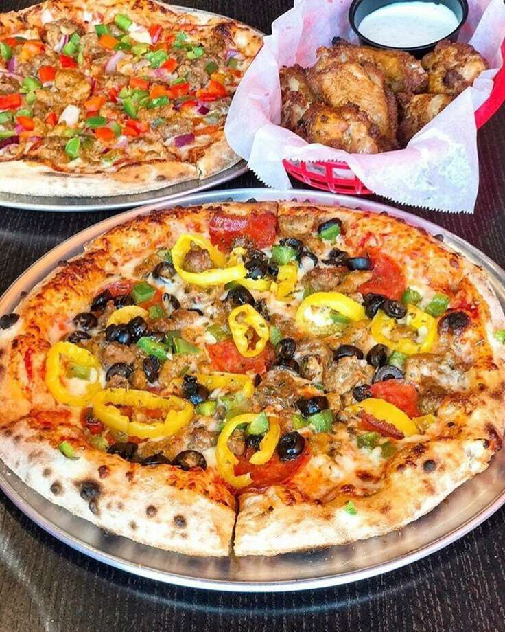 1000 Degrees offers signature pies and wings in addition to its make-your-own option. Photo: Courtesy Photo