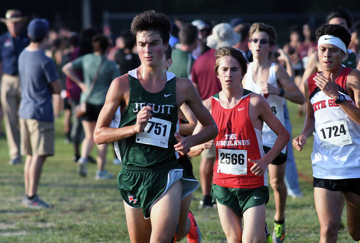 Strake Jesuit's Robert Botard (1751) runs ahead of The Woodland's Ryan Raiford (2566) and North Shore's Brian Martinez (1724) off the starting line during the Varsity Boys 5K race at the Andy Wells Invitational at Atascocita High School on Sept. 16, 2017. (Photo by Jerry Baker)