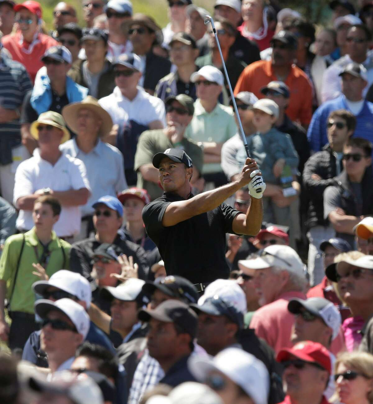 Tiger Woods hits a drive on the sixth hole during the second round of the U.S. Open Championship golf tournament Friday, June 15, 2012, at The Olympic Club in San Francisco. (AP Photo/Charlie Riedel)
