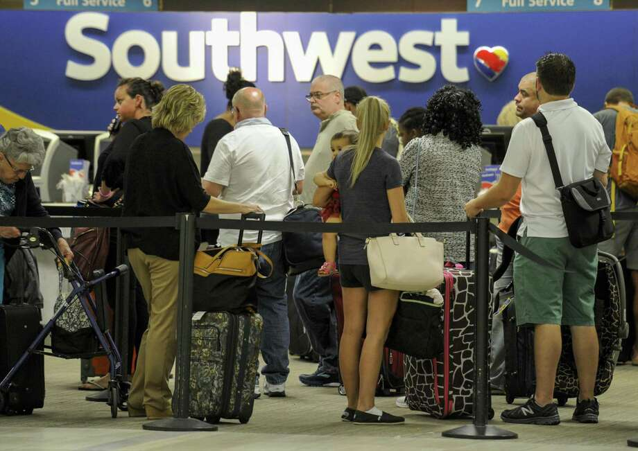 Passengers wait in line at the Southwest Airlines ticket counter on Sept. 6 at Tampa International Airport. On Thursday, Southwest Airlines Co. said about 5,000 flights had been canceled through Wednesday because of the recent natural disasters, the carrier said in a statement. Photo: Chris Urso /Associated Press / Tampa Bay Times