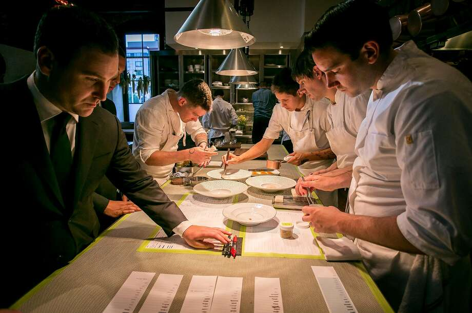 A team of cooks plates dishes at Saison, in San Francisco's SoMa neighborhood. The Michelin three-star restaurant is known for its tasting menu, which starts at $398 per person. Photo: John Storey, Special To The Chronicle