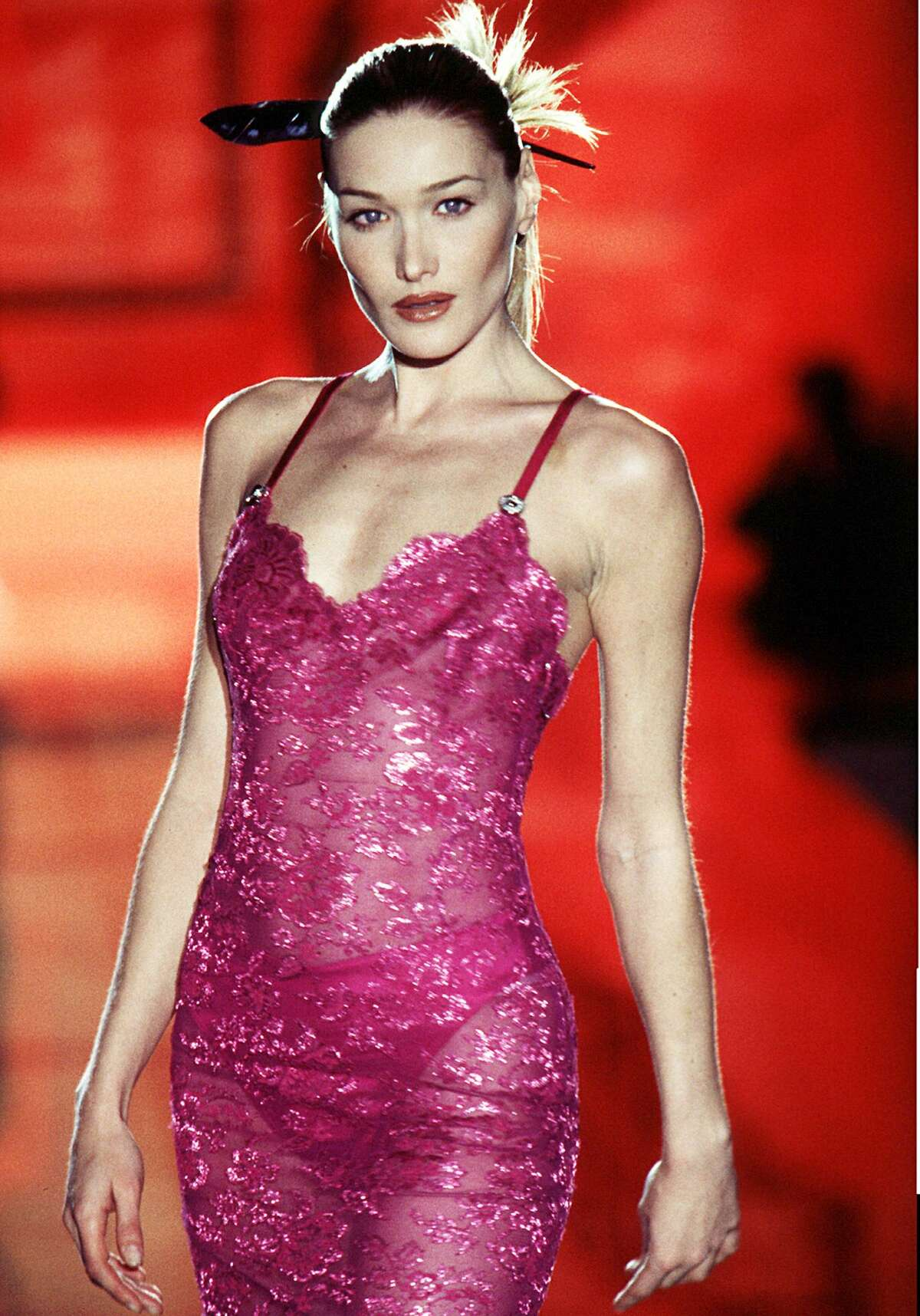PARIS, FRANCE - JANUARY 18: Model Carla Bruni walks the runway during the Versace Haute Couture Spring/Summer show as part of the Paris Haute Couture week on January 18, 1996 in Paris,France. (Photo by Victor VIRGILE/Gamma-Rapho via Getty Images)