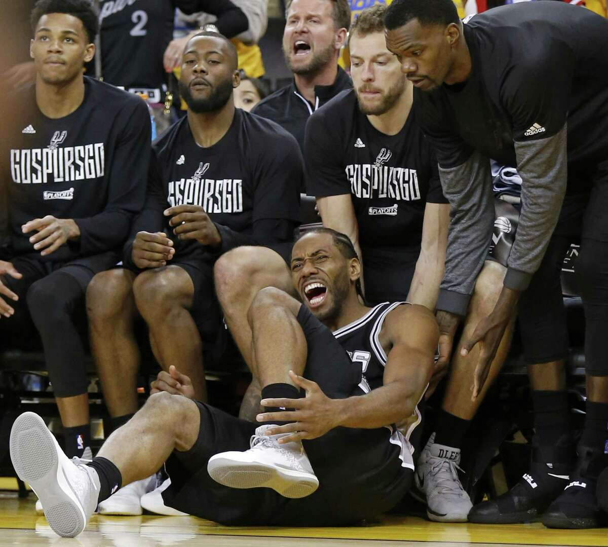 San Antonio Spurs' Kawhi Leonard reacts after being injured on a play during second half action of Game 1 in the Western Conference Finals against the Golden State Warriors Sunday May 14, 2017 at Oracle Arena in Oakland, CA. The Warriors won 113-111.