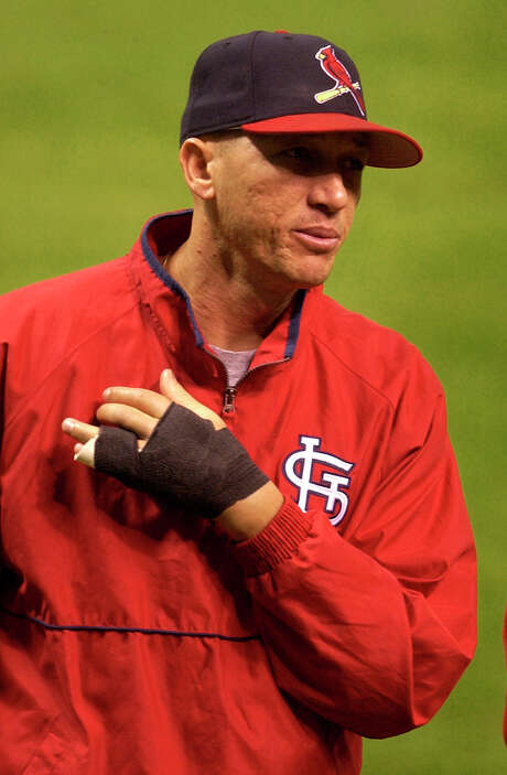 Giving up a homer in Game 4 to Carlos Beltran enraged Cardinals reliever Julian Tavarez so much he punched a dugout phone and broke his non-pitching hand. Photo: PAT SULLIVAN, AP / AP