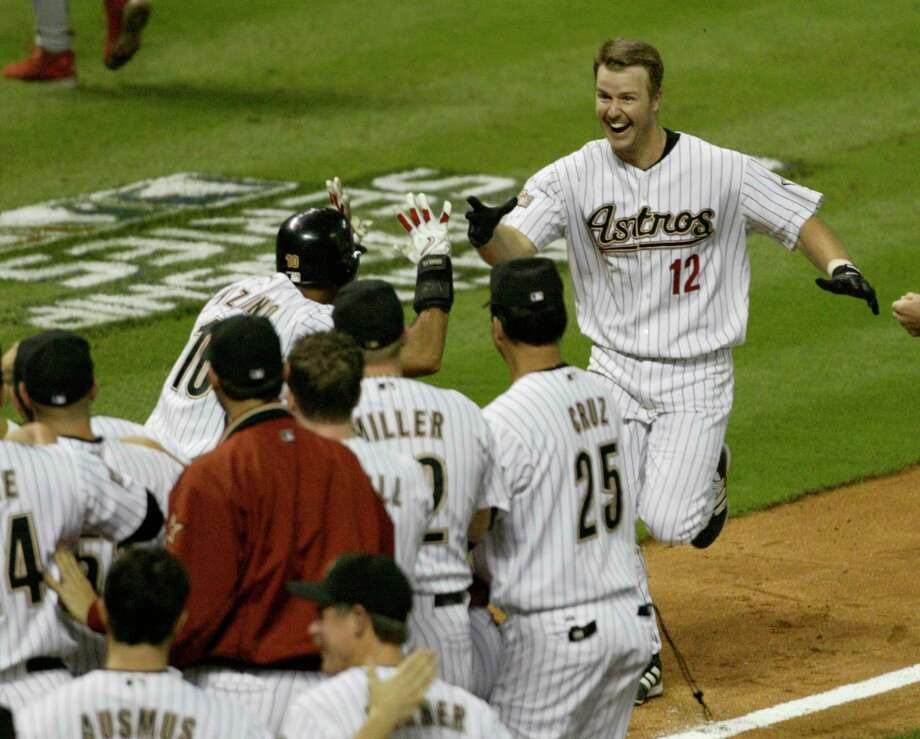 After the Cardinals decided to pitch to him with two runners on in the ninth inning of Game 5, Jeff Kent (12) made them pay with one of the most memorable home runs in Astros history, putting the team one win away from the World Series. Photo: Buster Dean, Houston Chronicle / Houston Chronicle