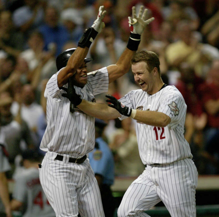 Jose Vizcaino, left, celebrated with Jeff Kent and said it felt like the Astros won the NLCS after the latter's walkoff homer. All they needed was one win in two games at St. Louis to get to their first World Series. Photo: Karen Warren, Houston Chronicle / Houston Chronicle