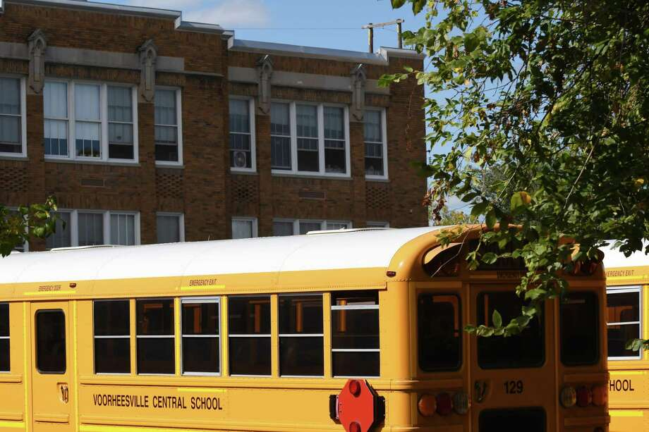Voorheesville Central School District buses are parked outside the elementary school on Thursday, Sept. 28, 2017, in Voorheesville, N.Y. (Will Waldron/Times Union) Photo: Will Waldron, Albany Times Union / 20041649A