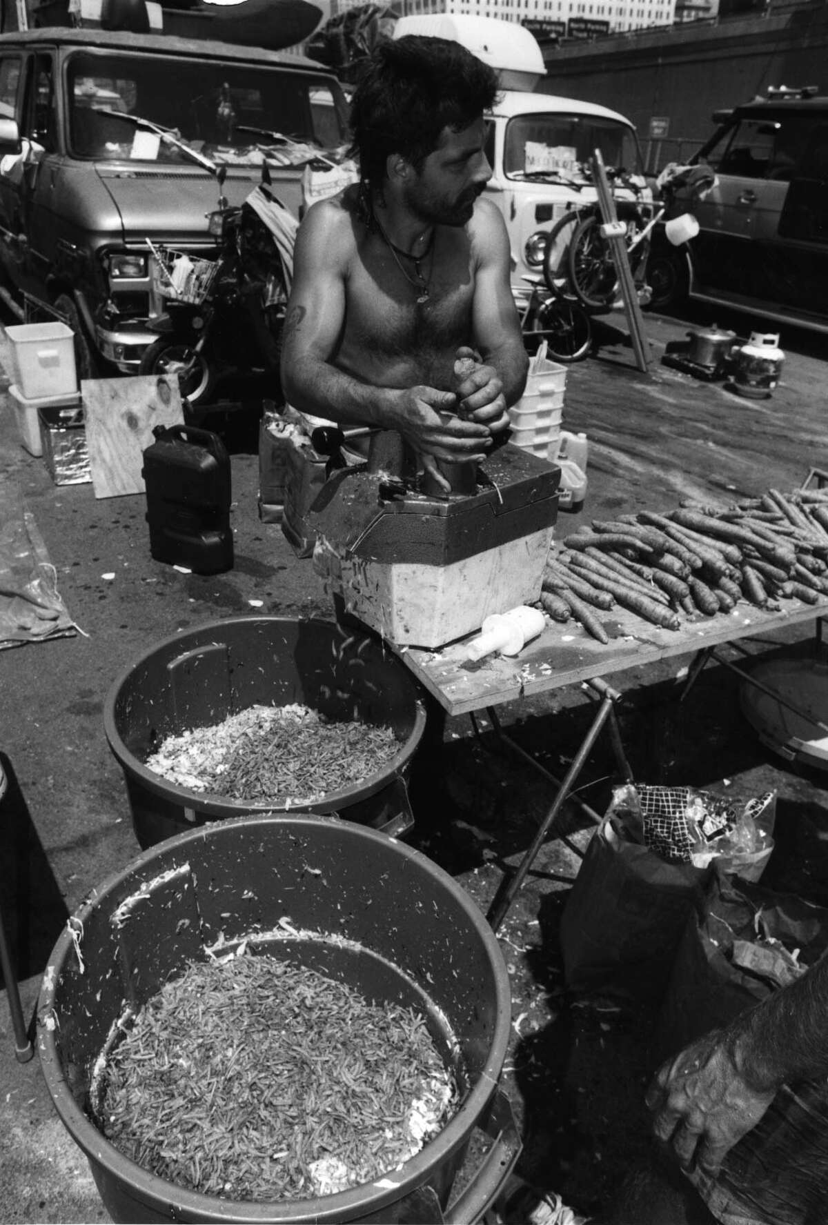 Ray Butler of Caribou, Maine, makes some Jerry Garcia egg rolls out of all natural veggies in Albany on the day the Grateful Dead played the Knickerbocker Arena. 6/12/1992.