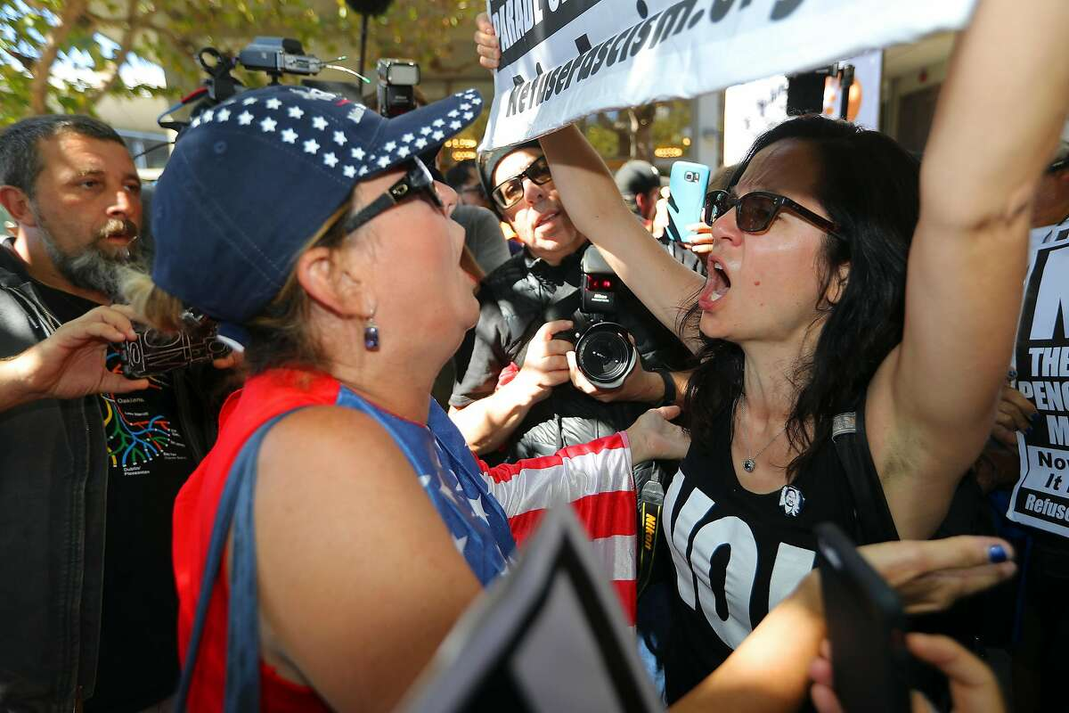 Genevieve Peters, left, a Trump supporter, and Sunsara Taylor, with the grooup Refuse Fascism exchange words at the University of California, Berkeley where a brief appearance by right-wing provocateur Milo Yiannopoulos drew both supporters and counter-protesters, in Berkeley, Calif., Sept. 24, 2017. Yiannopoulos had said the day before that he would show up at the unsanctioned rally after a planned four-day event dubbed Free Speech Week was canceled. (Jim Wilson/The New York Times)