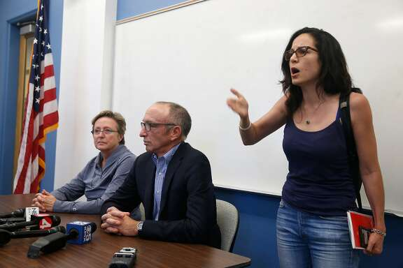 Sunsara Taylor (right) interrupts a news conference by UC Berkeley police chief Margo Bennett and campus spokesman Dan Mogulof at UC Berkeley, Calif. on Saturday, Sept. 23, 2017 to comment on the apparent cancellation of Free Speech events originally planned for next .