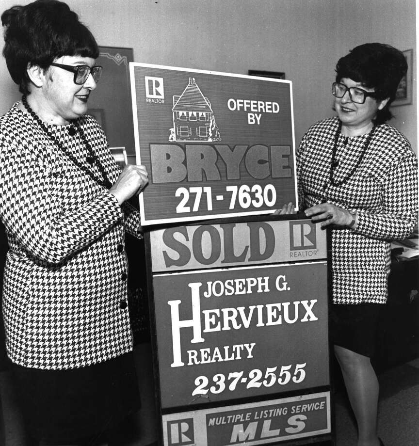Carol A. Hervieux Potts and her twin sister, Judith M. Hervieux, in their real estate office. 4/6/1992.