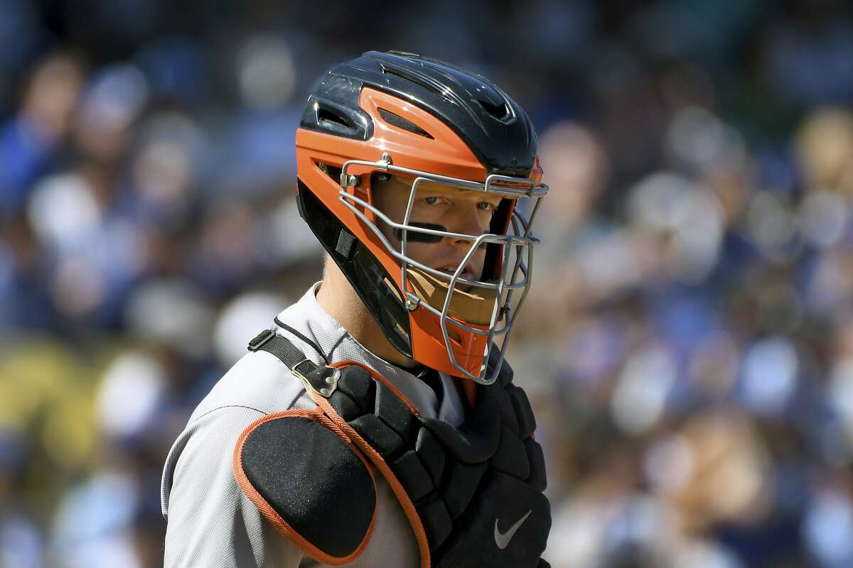 San Francisco Giants catcher Nick Hundley looks for signs from the dugout during a baseball game against the Los Angeles Dodgers, Sunday, Sept. 24, 2017, in Los Angeles. (AP Photo/Michael Owen Baker)