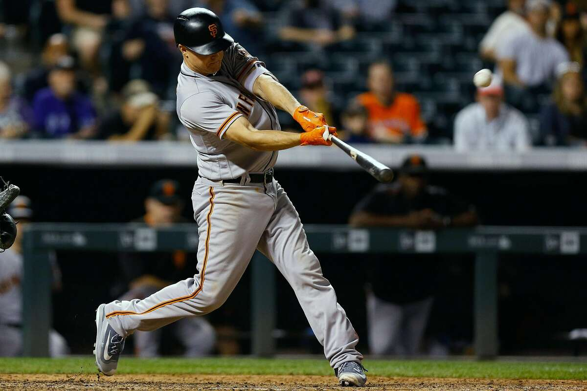DENVER, CO - SEPTEMBER 6: Nick Hundley #5 of the San Francisco Giants hits a two run home run during the eighth inning against the Colorado Rockies at Coors Field on September 6, 2017 in Denver, Colorado. The Giants defeated the Rockies 11-3. (Photo by Justin Edmonds/Getty Images)