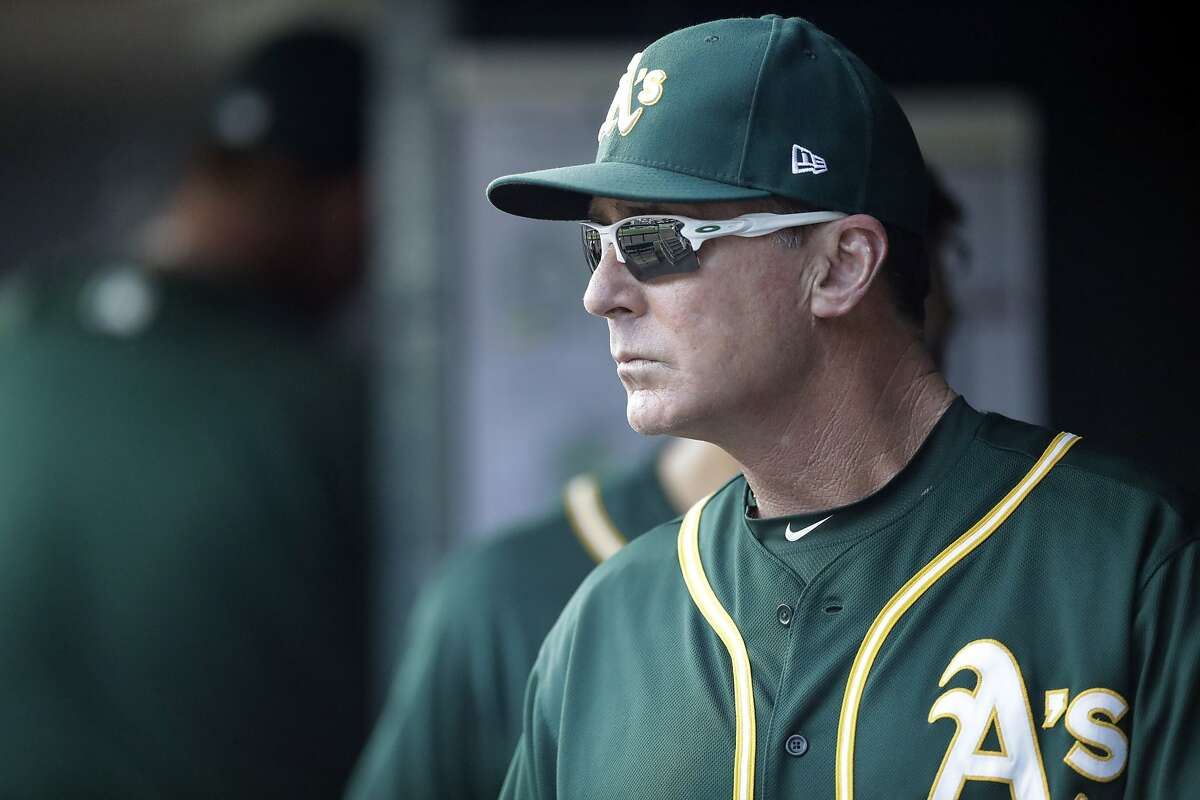 Oakland Athletics manager Bob Melvin looks from the dugout during the eighth inning of a baseball game against the Detroit Tigers, Wednesday, Sept. 20, 2017, in Detroit. (AP Photo/Carlos Osorio)