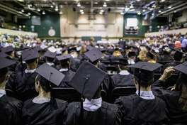 Students attend a graduation ceremony at Motlow State Community College in Tullahoma, Tenn., in May 6.