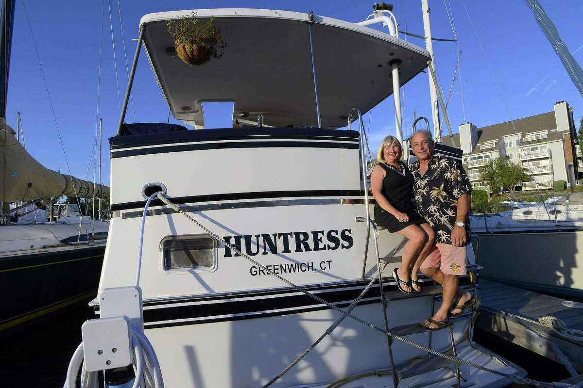 Jonathan Asch and Aileen Hutchins live on their boat named Huntress that they dock during the summer at Palmer Landing in Stamford, Connecticut on Friday, Sept. 22, 2017.