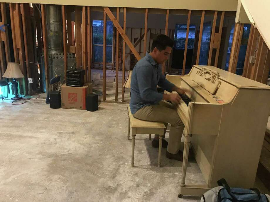 Eric Torres lost his baby grand piano after his home was flooded with three feet of water leading him to receiving a piano from a willing donor. Eric's band Lives of Nick plans to start a fundraiser to help those impacted by Hurricane Harvey. Photo: Courtesy Photo
