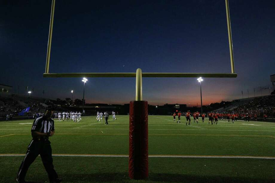 The sun sets as Caney Creek and New Caney take a timeout during the varsity football game on Friday, Sept. 22, 2017, at Moorhead Stadium. (Michael Minasi / Chronicle) Photo: Michael Minasi, Staff Photographer / © 2017 Houston Chronicle