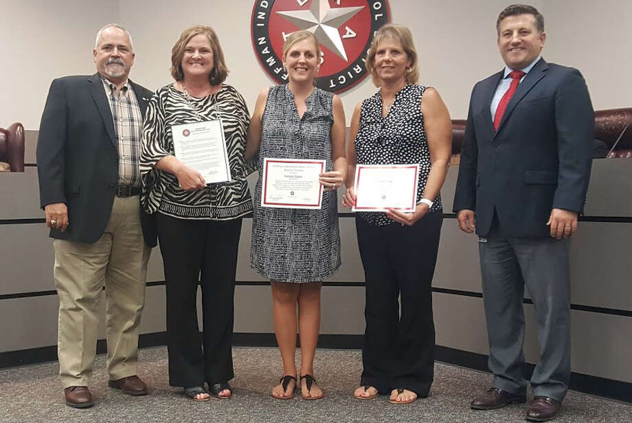The Huffman ISD HR/PR department are recognized during the school board meeting on Monday, Sept. 25. From left to right: school board member Ray Burt, Shirley Dupree, Stephanie Wiggins, Susan Young, superintendent Benny Soileau. Photo: Melanie Feuk