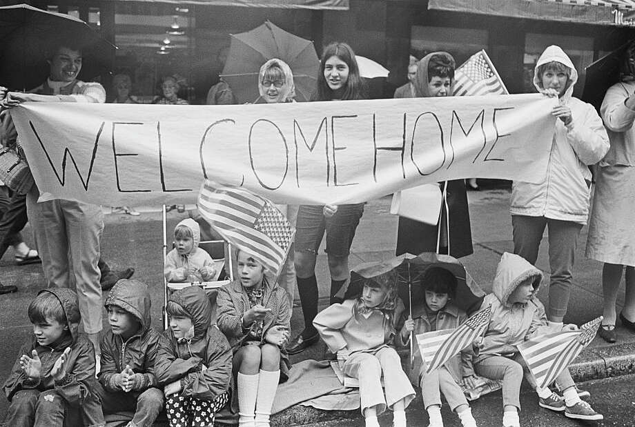 Family members of the soldiers of the United States Army's 3rd Battalion, 60th Infantry, 9th Division, hold American flags and Welcome Home signs as they wait for the first troops returning to Seattle from Vietnam during the Vietnam War. (Photo by © Doug Wilson/CORBIS/Corbis via Getty Images) Photo: Doug Wilson/Corbis Via Getty Images