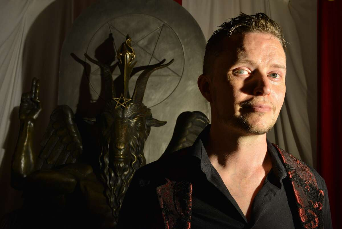 Lucien Greaves, spokesman for The Satanic Temple, with a statue of Baphomet at the group's meeting house in Salem, Mass. Scroll ahead for a timeline of the group's history.