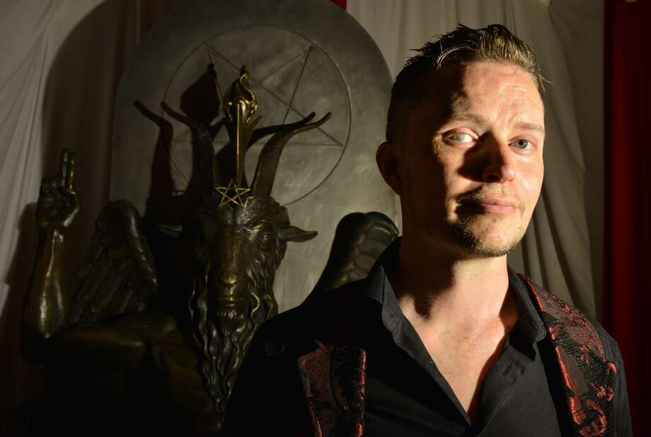 SALEM, MA - JULY 25: Lucien Greaves, spokesman for The Satanic Temple, with a statue of Baphomet at the group's meeting house in Salem, MA. The Satanic Temple, a group of political activists who identify themselves as a religious sect, are seeking to establish After-School Satan clubs as a counterpart to fundamentalist Christian Good News Clubs, which they see as the Religious Right to infiltrate public education, and erode the separation of church and state. (Photo by Josh Reynolds for The Washington Post via Getty Images) Photo: (Photo By Josh Reynolds For The Washington Post Via Getty Images)