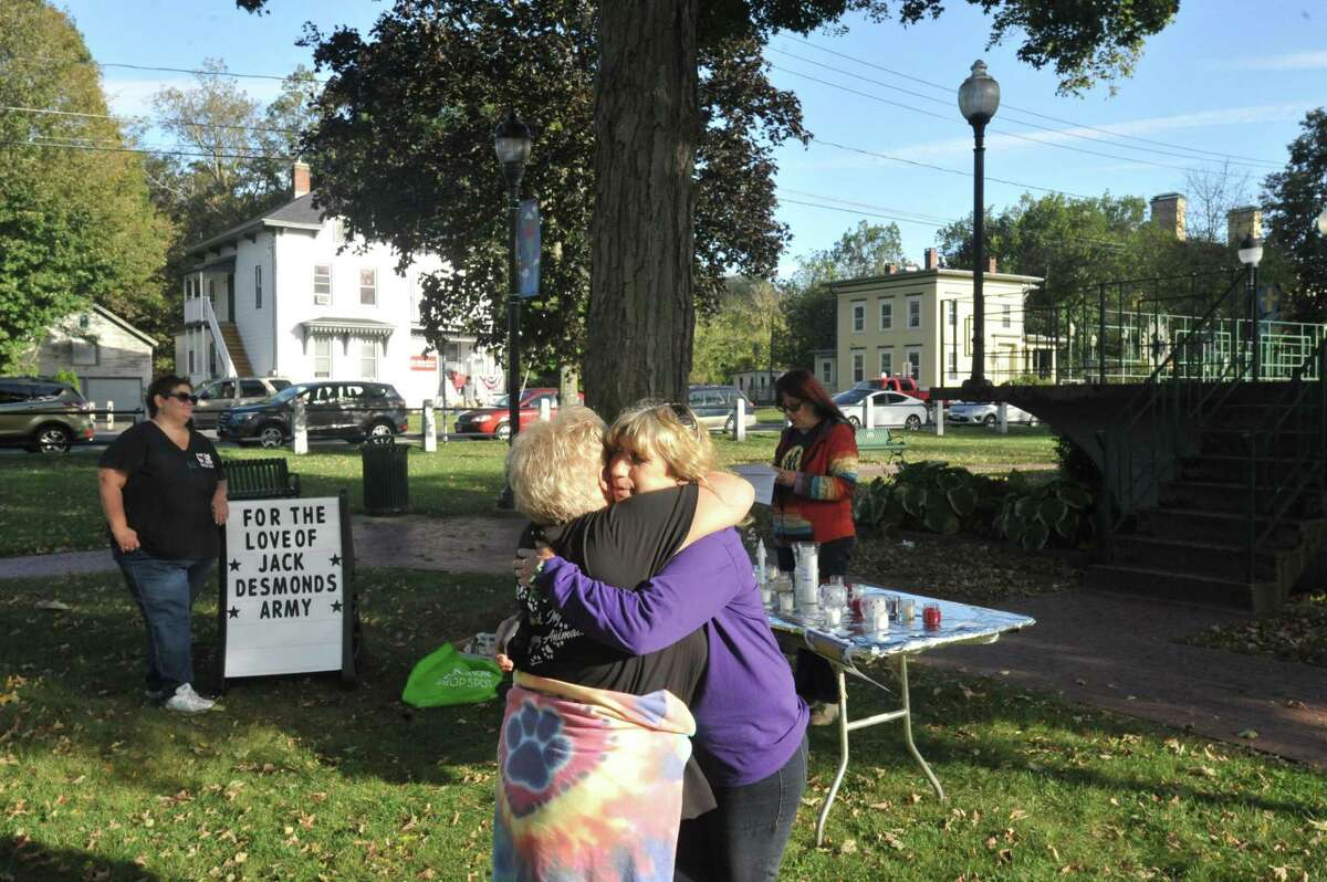"""Local residents gathered to mark """"Remember Me Thursday,"""" an international day of remembrance for orphaned animals, in Winsted's East End Park."""