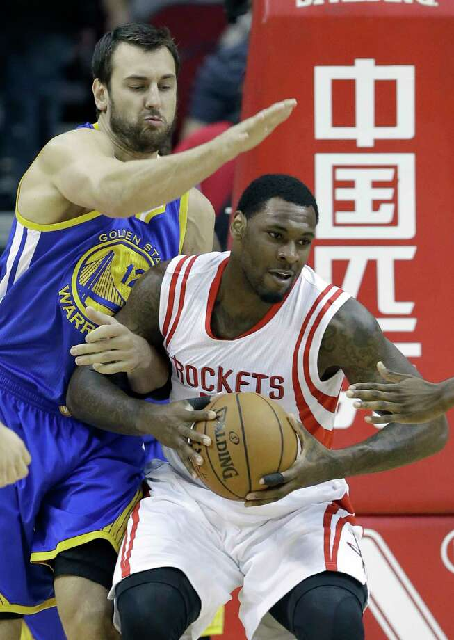 Golden State Warriors' Andrew Bogut (12) holds onto Houston Rockets' Tarik Black in the first half of an NBA basketball game Saturday, Nov. 8, 2014, in Houston. (AP Photo/Pat Sullivan) Photo: Pat Sullivan, STF / AP