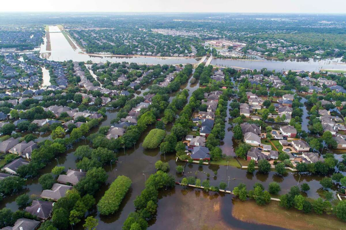 Homes in the Cinco Ranch area are surrounded by water from Barker Reservoir in Houston on Sept. 2. (Mark Mulligan / Houston Chronicle)
