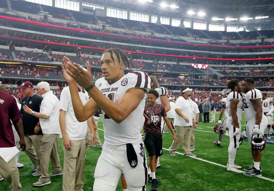 Texas A&M quarterback Kellen Mond (11) celebrates after an NCAA college football game against Arkansas on Saturday, Sept. 23, 2017, in Arlington, Texas. (AP Photo/Tony Gutierrez) Photo: Tony Gutierrez, STF / Copyright 2017 The Associated Press. All rights reserved.