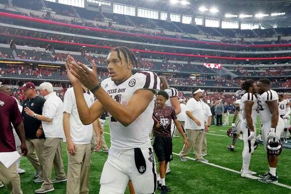 Texas A&M quarterback Kellen Mond (11) celebrates after an NCAA college football game against Arkansas on Saturday, Sept. 23, 2017, in Arlington, Texas. (AP Photo/Tony Gutierrez)