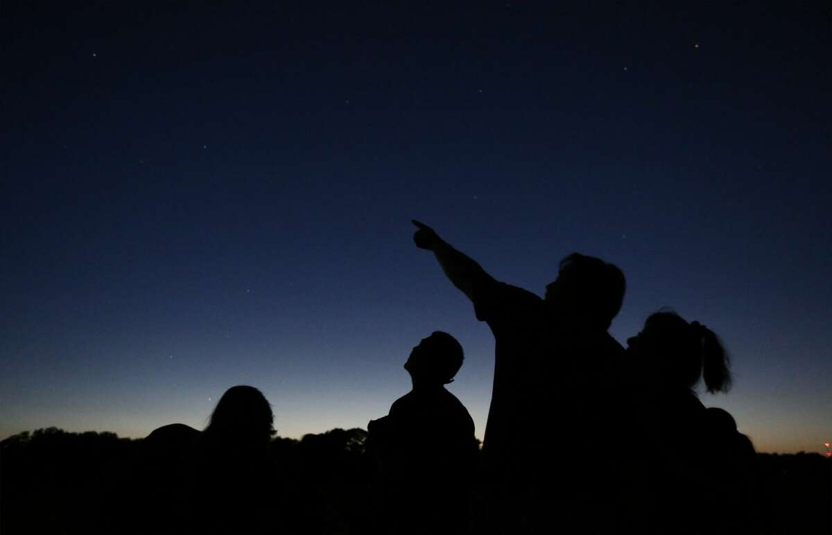 People gather for star gazing. Stock image. (Kin Man Hui/San Antonio Express-News)
